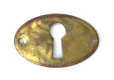 Antique Stamped Brass Keyhole Escutcheon or Cover